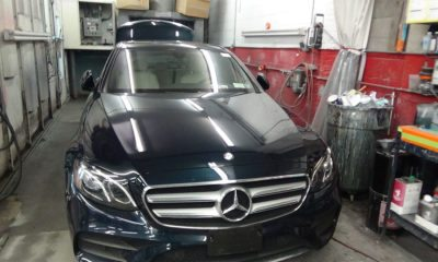black mercedes in repair shop