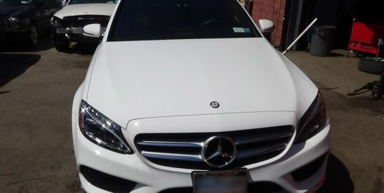 white mercedes being repaired
