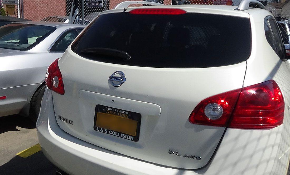 Nissan van in autobody repair shop